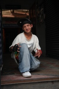 A shot of modern Nepal, a young boy displaying his western attitude