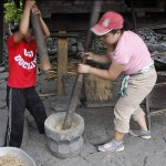 Karina and Joy pounding rice