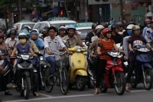 Bikes, cars, and motorbikes intermingle