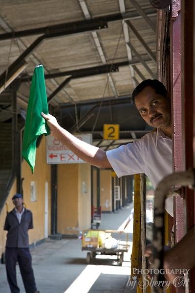 train conductor green flag