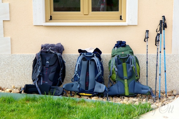 Backpacks lined up at a cafe on the Camino trail