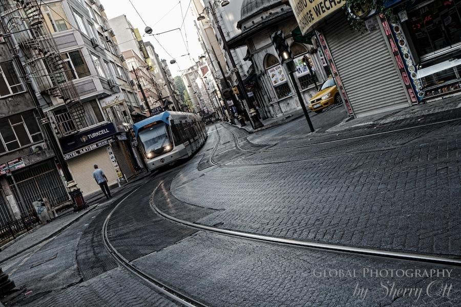 The tram runs down an empty street