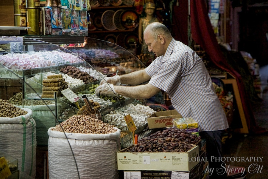 man replenishes inventory in the spice market