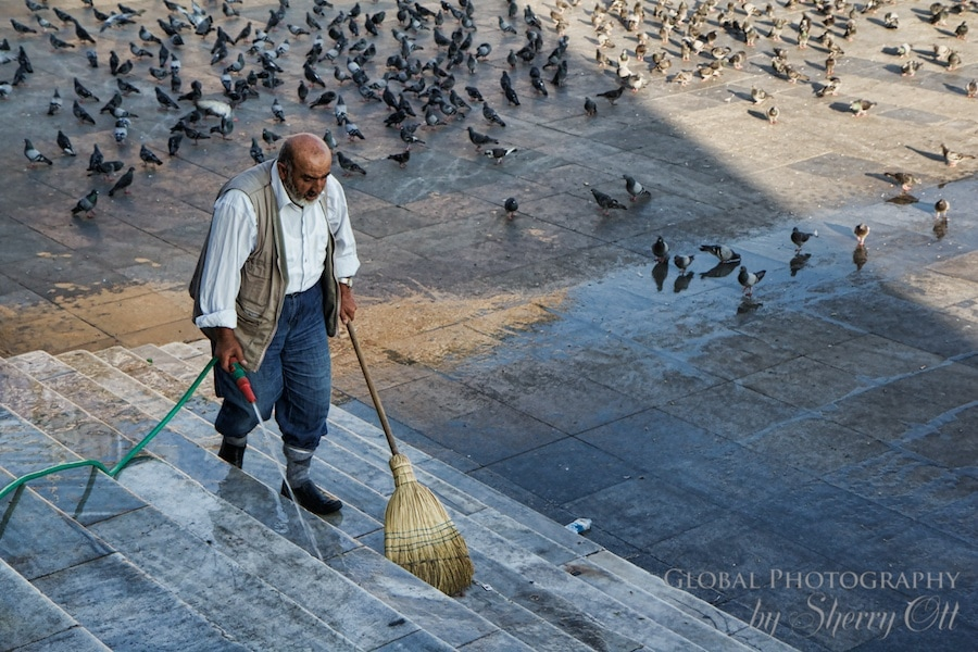 Man cleaning the stairs of the new mosque