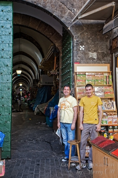 two men at the entrance of the spice market