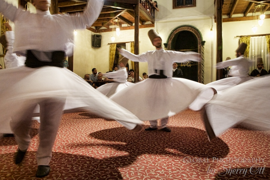 Dervishes move around each other in a circular pattern