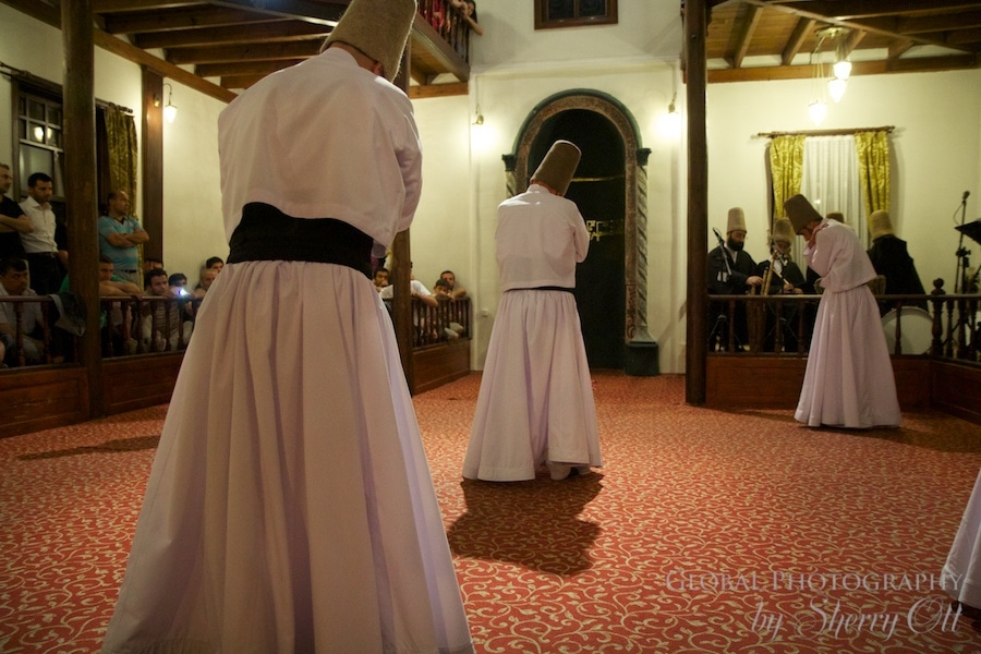 whirling dervish finish the spinning part of the ceremony