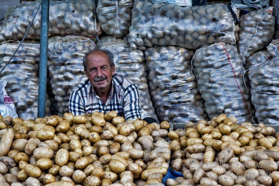 man selling potatoes at the selcuk market turkey
