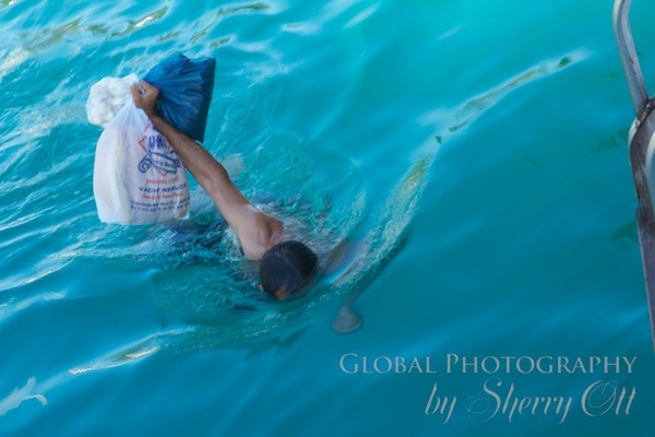 Osman swims back to the boat with our fish and bread