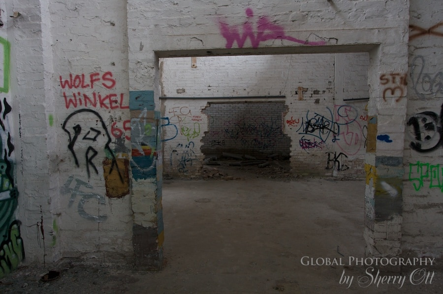 An abandoned building is riddled with tags