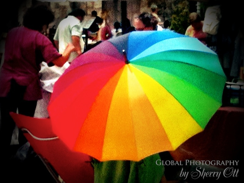 A colorful rainbow umbrella in Costa Brava Spain