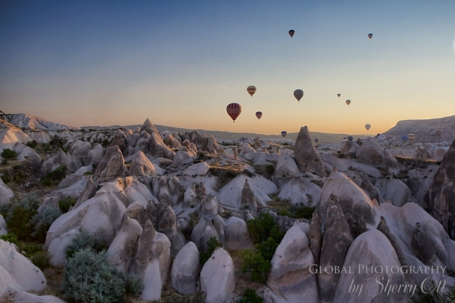Hot air balloons in the sky above Cappadocia Turkey