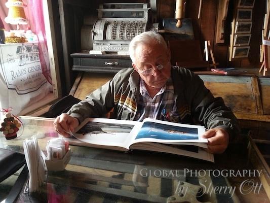 Dad looking at an Antarctica photography book