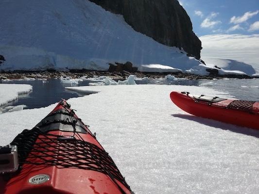 Kayaking up onto fast ice