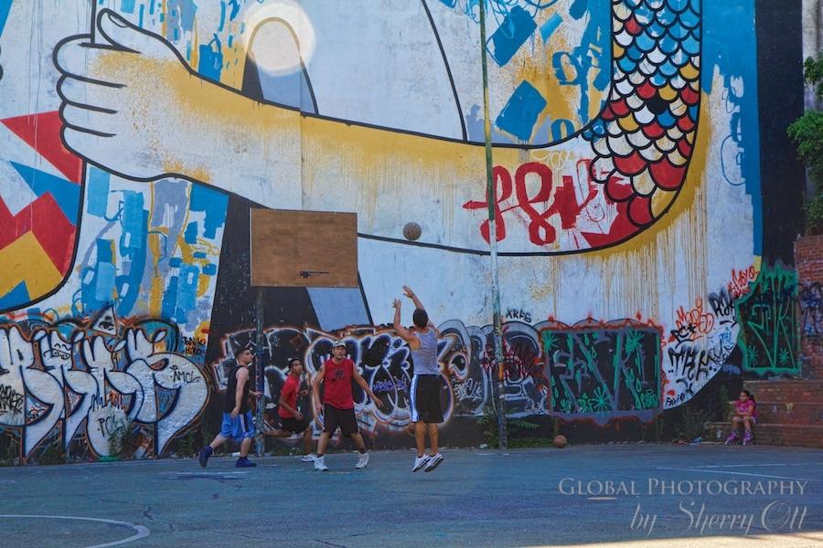 a basketball game amidst graffiti