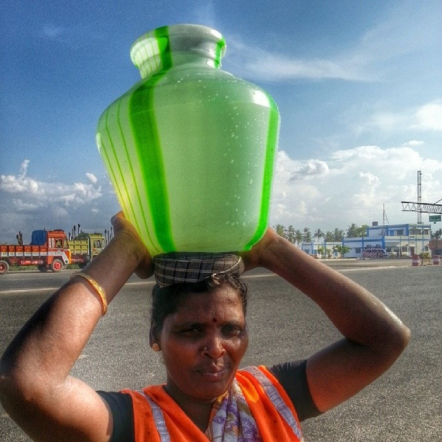 woman carries water on her head