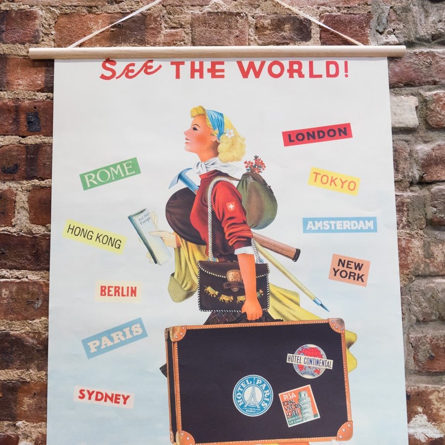 vintage poster of a woman with a suitcase and lots of destination names. she's probably traveling alone for the first time