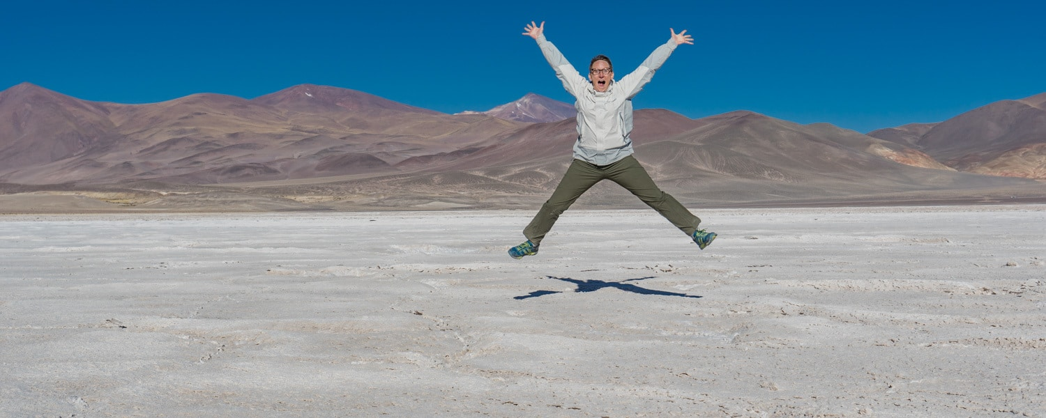 me jumping on salt planes with mountains in the background
