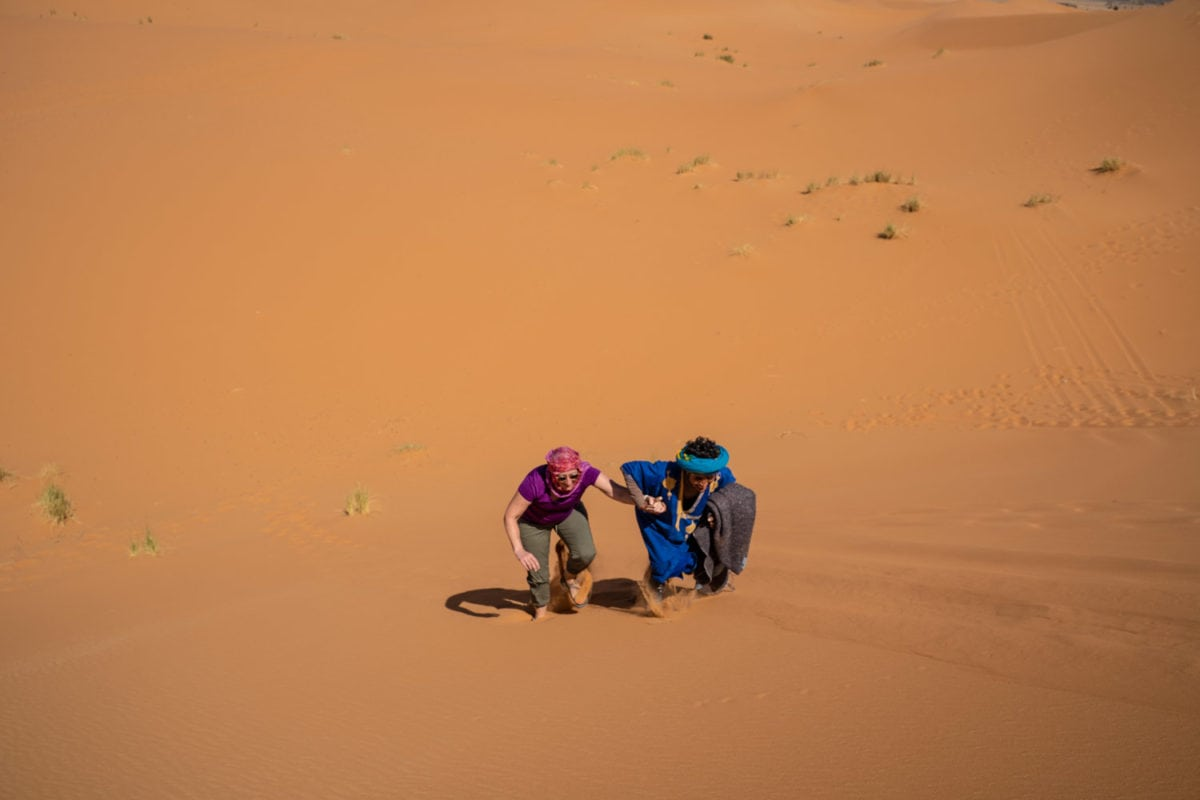 walking up a sand dune