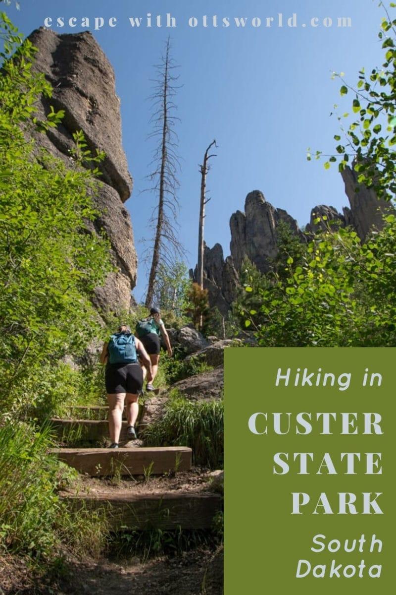 hikers on uphill rocky path custer state park south dakota usa