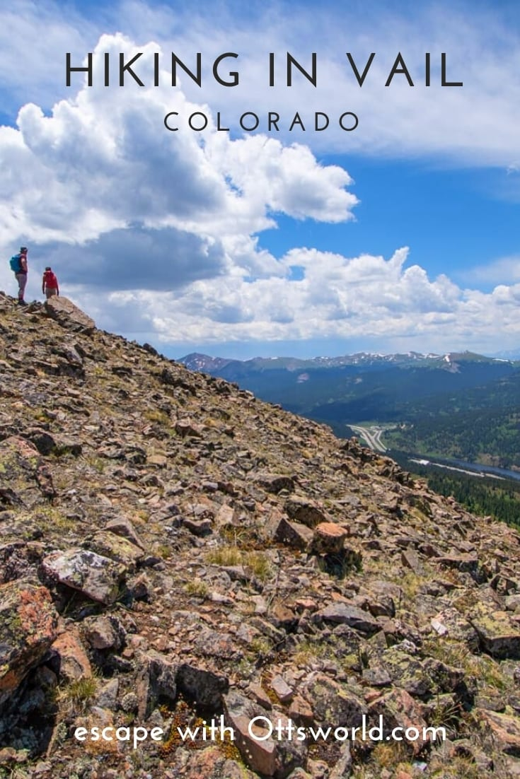 Hikers on rocky mountain side in Vail Colorado