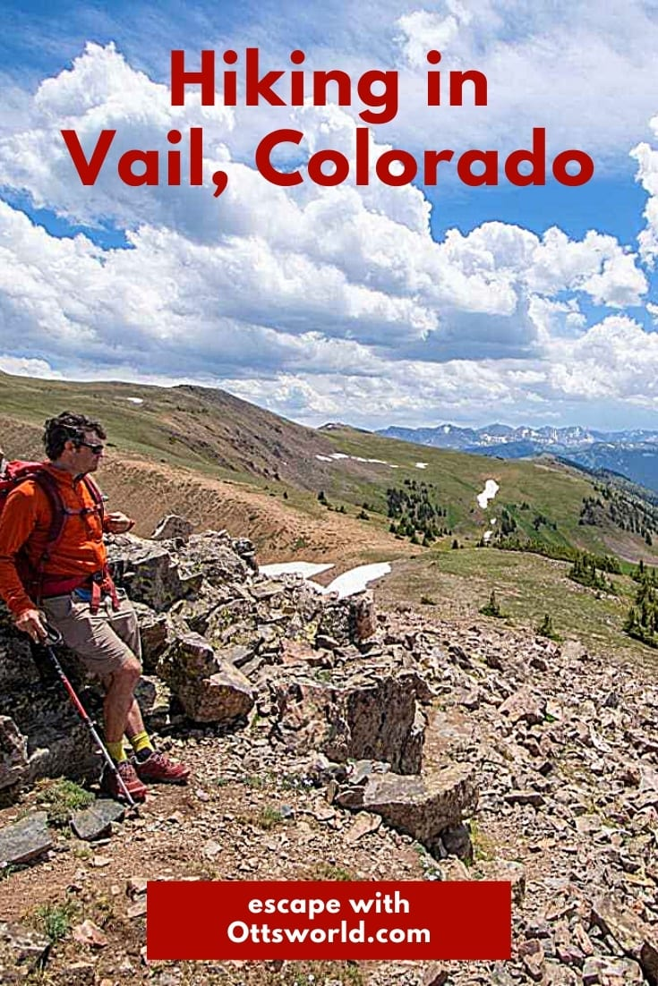 Hiker on rocky slope in Vail Colorado
