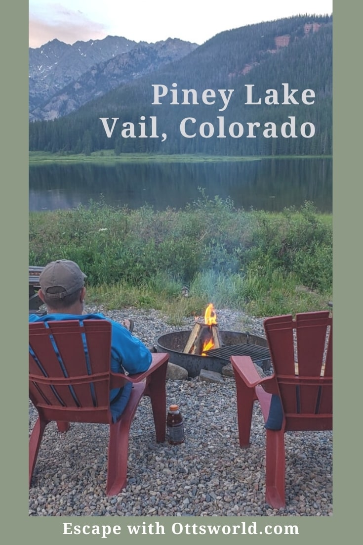 man adirondack chairs campfire mountain lake