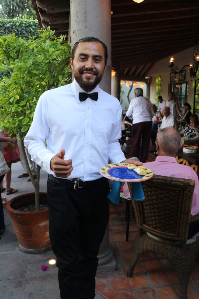 Server holding appetizers San Miguel Mexico